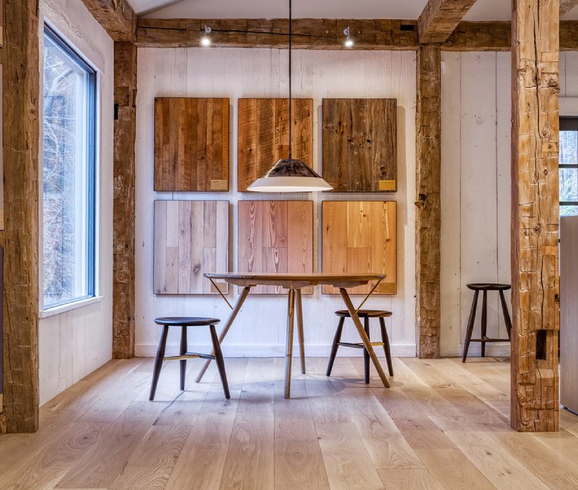 our show room, cosy wooden place. two chairs and table surounded by wooden walls